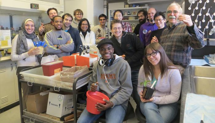 large group of smiling students in a science lab